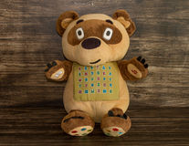 Soft toy bear. Wooden background Royalty Free Stock Photo