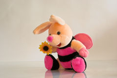 Soft toy bee. On a beige background Stock Photos