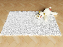 Soft  toy on the carpet Stock Photos