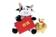 Soft Toy Cow with Chinese New Year Decorations. On White Background