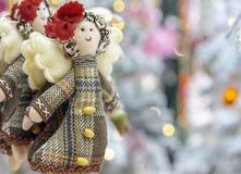 Soft toy doll in a coat with angel wings stock image