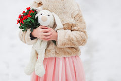 Soft toy, a flower in the hands of a girl. gift. Spring, winter. Royalty Free Stock Photo