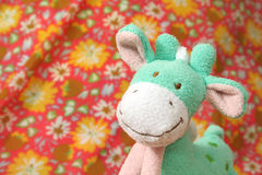 Soft toy giraffe. Soft toy green giraffe or horse Stock Images