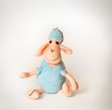 Soft toy lamb. On a white background royalty free stock photography