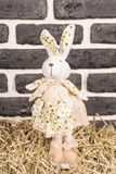 Toy rabbit in the hay royalty free stock photos