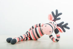 Soft toy lying elk Stock Photography