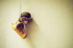 Soft toy on the old grunge wall ,retro and vintage style  Soft f Royalty Free Stock Images