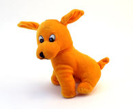 Soft toy - orange dog with long ears. Isolated on white background Royalty Free Stock Photography
