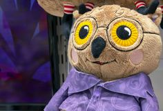 A soft toy owl in lilac outfit. Toy owl close up stock image