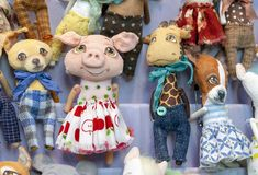 Soft toy pig in a dress on the background of other animals royalty free stock photo