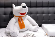 Soft toy polar bear with an orange scarf royalty free stock photos