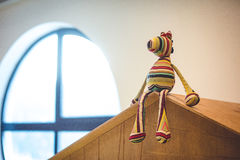 Soft toy. A soft toy sits on the roof of a toy house Royalty Free Stock Images
