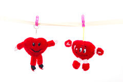 Soft toy strapped clothespins hanging heart on Valentine`s Day.  Royalty Free Stock Images