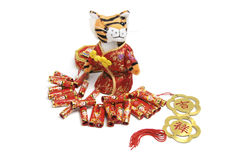 Soft Toy Tiger and Firecrackers Royalty Free Stock Images