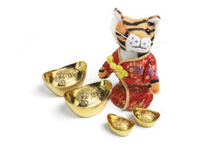 Soft Toy Tiger with Gold Ingots Royalty Free Stock Photo