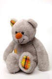 Soft Toy on White Isolated Background. Gray Teddybear Sitting on White Isolated Background Royalty Free Stock Images