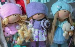 Soft toys dolls in bright knitted things royalty free stock photo