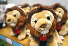 Soft toys lion cubs for children on the counter of the store stock image