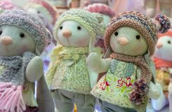 Soft toys of the mouse in dresses and knitted hats.  royalty free stock images