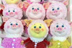 Soft toys piggies with expressive blue eyes.  royalty free stock image