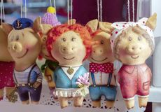 Soft toys piglets in different clothes on the counter of a children`s store royalty free stock photography
