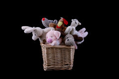 Soft toys in a wattled basket Royalty Free Stock Images