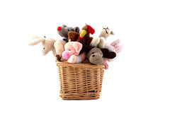 Soft toys in a wattled basket Royalty Free Stock Image