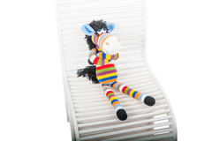 Soft toys zebra sitting in the chair Royalty Free Stock Photography