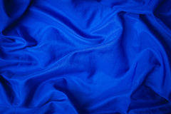 Soft velvet piece of blue fabric. With folds to be used as background Royalty Free Stock Image
