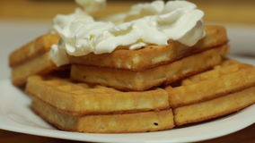 Soft waffles with cream. Add whipped cream on the soft waffles stock footage