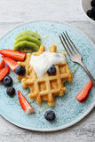 Soft waffles with yoghurt and fruits. Breakfast royalty free stock photos