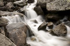 Soft water. Water running down the rocks Royalty Free Stock Image