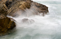 Soft water on rocks Royalty Free Stock Photo