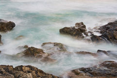 Soft water on rocks Royalty Free Stock Photos
