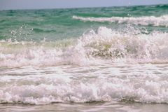 Soft Wave Of Blue Ocean On Sandy Beach. Background royalty free stock photo