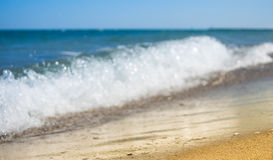 Soft wave of blue ocean on sandy beach. Background royalty free stock image