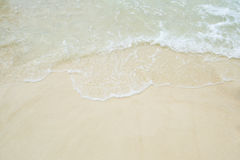 Soft wave of blue ocean on sandy beach. Background. Royalty Free Stock Photography