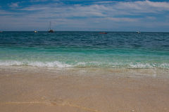Soft wave of blue ocean on sandy beach Stock Images