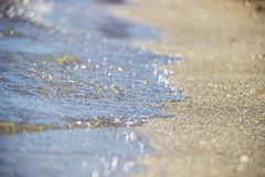 Soft Wave Of Blue Ocean On Sandy Beach. Background. Selective focus. Stock Image