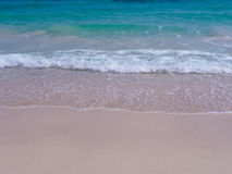 Soft Wave Of Blue Ocean On Sandy Beach. Background. stock photography