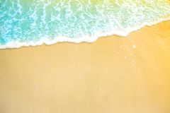 Soft wave of blue ocean on sandy beach. background. selective focus. beach and tropical sea white foam on beach. Soft focus on bottom of picture stock photo