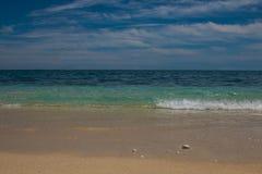 Soft wave of blue ocean on sandy beach Stock Photography