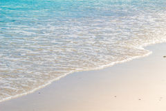 Soft wave of blue ocean on wet sandy beach. Background Royalty Free Stock Photos