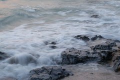 Soft wave is hitting the rocks. Soft wave is hitting the rocks, .Image may contain soft focus and blur due to long exposure Royalty Free Stock Photography