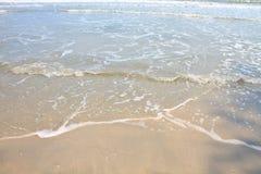 Soft wave on the sandy beach Stock Photography