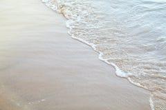 Soft wave on the sandy beach summer tropical concept. stock photos