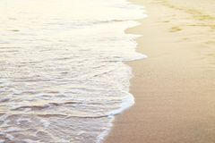 Soft wave on the sandy beach summer tropical concept. royalty free stock photography