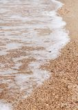 Soft wave of the sea on the beach Stock Photography