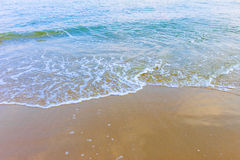 Soft wave of the sea on the beach Stock Photo