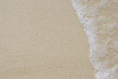 Soft wave of the sea on sand beach Stock Images